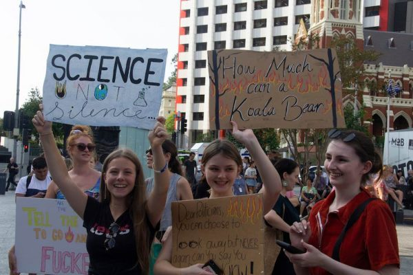 Girls at Climate Change Protest March holding placards