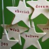 'joy' word star - ceramic Christmas decoration by Kylie Johnson