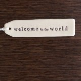 Kylie Johnson ceramic tag - welcome to the world