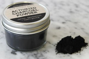 Activated charcoal powder in jar